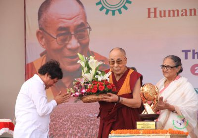 Prof. Achyuta Samanta presenting flowers to His holiness The Dalai Lama